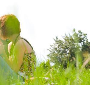 woman field offscreen green